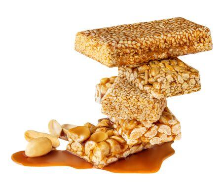 Caramel Nut bars with peanut isolated on white background. Heap of Granola energy  organic bars