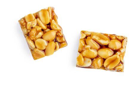 Peanut granola  bar with honey and caramel  isolated on white background. Muesli energy  Nut  bar top view Banco de Imagens