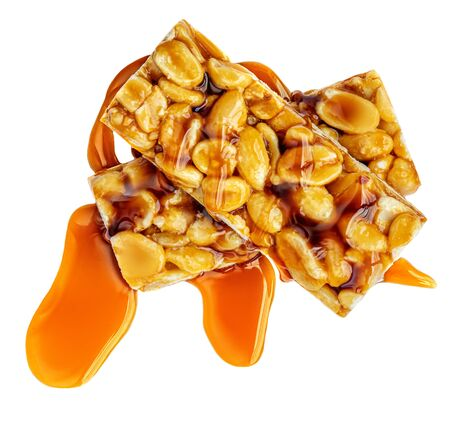 Nut bars with peanuts  and caramel  isolated on white background. Muesli energy  cereal  bar top view