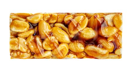 Granola Bar Isolated on White Background. Nut bar with peanuts  and caramel  toffee  syrup, top view Banco de Imagens