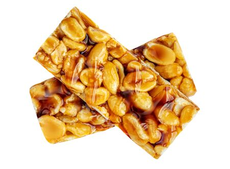 Granola Bar Isolated on White Background. Nut bar with peanuts  and caramel  syrup, top view Banco de Imagens