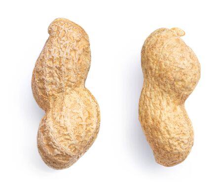 Peanuts isolated on the white background. Roasted nut macro. Banco de Imagens