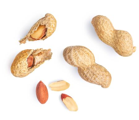 Peanuts isolated on the white background.  Dried crushed  Roasted nuts macro. Top view