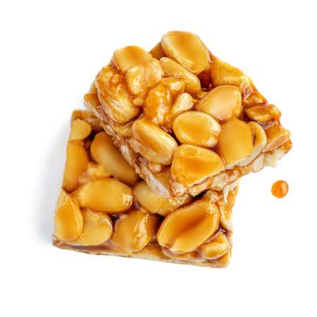 Sesame nut bar isolated on white background. Granola energy cereal bar closes up