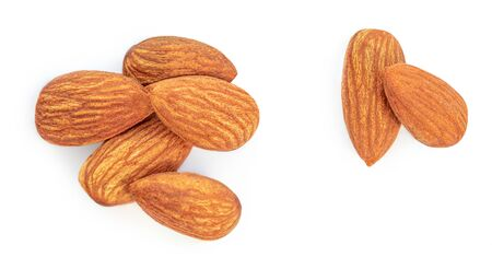 Almond Nuts. Closeup of almonds isolated on the white background. Flat lay Banco de Imagens