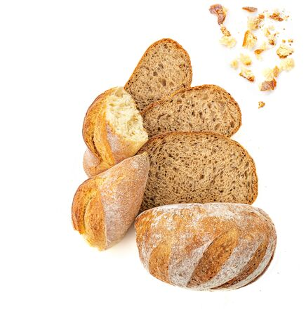 Top view of sliced wholegrain bread  isolated on white background. Bread slices and crumbs viewed from above.