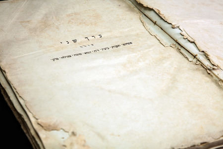 Old book cover, vintage texture, isolated on black background. Old Jewish Talmud in Yiddish. 版權商用圖片