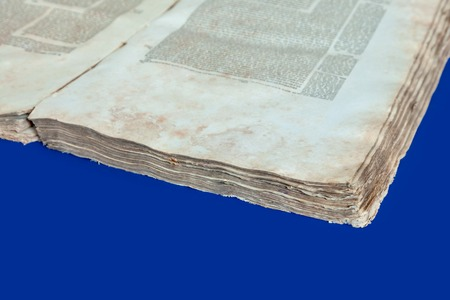 Old book cover, vintage texture, isolated on blue background. Old Jewish Talmud in Yiddish with Bible.