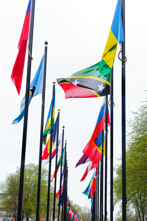 Many flags on the street in Europe In the Netherlands as a symbol of friendship between peoples and nations. Waving flags of different countries along the road in The Hague.