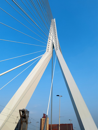 The Erasmus bridge in the Rotterdam. White metal reliances on the blue sky background with sunlight. Stok Fotoğraf