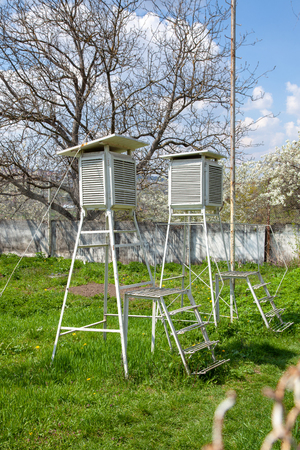 Devices of meteorological station on the blue sky. Place for meteorology with sunlight in good weather. Archivio Fotografico