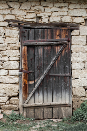 Old stone houses with door by the typical Authentic Ukrainian countryside.