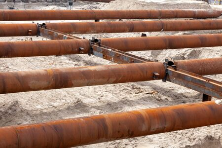 Big pipes on the shore North sea for flood water evacuation system. Installation and assembly sistem for save water level and protection from flooding. 写真素材