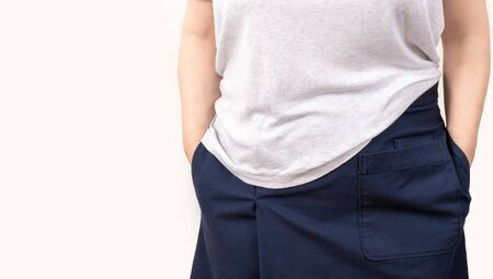 Woman is holding empty pockets on her clothes, isolated on white background.