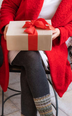 Woman Hands hold Gifts on the eve of holidays Christmas and New Year.