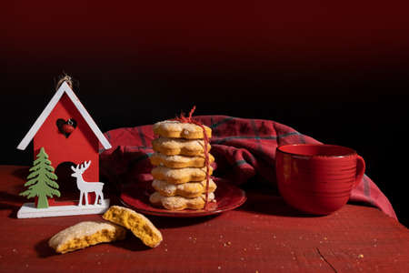 Set Biscuits on Red Wooden table with Red Cup of coffee and New Year Toy