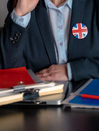 Lawyer or Office Employee or Civil Servant near his Workplace with Great Britain Flag on a Jacket Icon