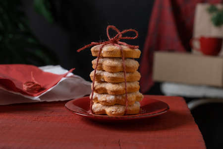 Set Biscuits on Red Wooden table on the black background