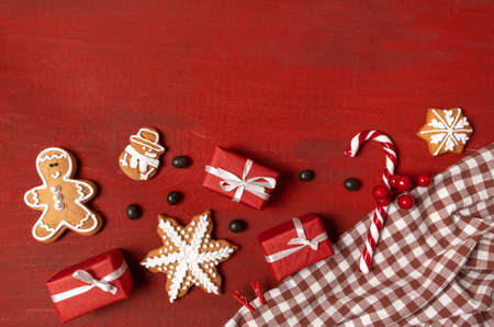 Set Festive New Year Biscuits, Gifts and Snowflake on Red Wooden Background Banco de Imagens - 160734174