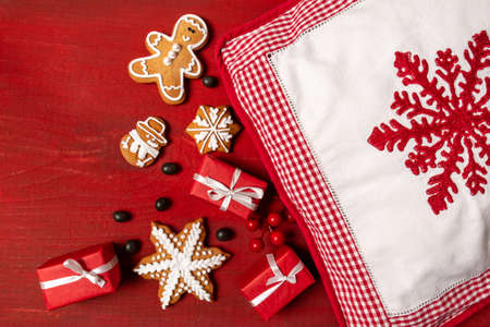 Set Festive New Year Biscuits, Gifts and Pillow with red Snowflake on Red Wooden Background Banco de Imagens - 160734175
