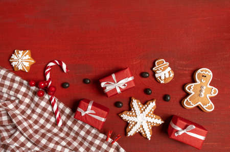 Set Festive New Year Biscuits, Gifts and Snowflake on Red Wooden Background Banco de Imagens - 160734179