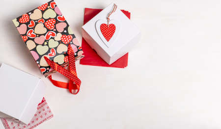 Shopping bag, white box and red Heart of Valentine's Day on white background Banco de Imagens
