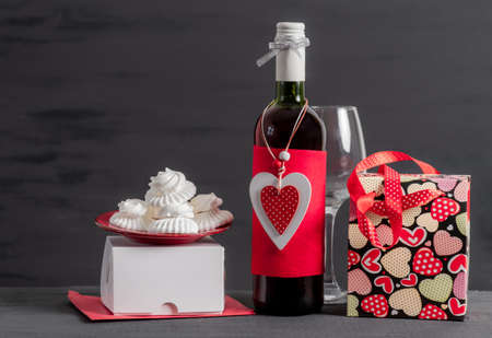Wine Bottle, Shopping bag, white box and red Heart of Valentine's Day on the black background Banco de Imagens - 160894493