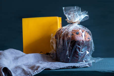 Easter panetone italian in packaging with a yellow box on the blue background.