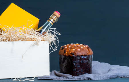 Easter panetone italian in packaging with champagne bottle on the blue background.