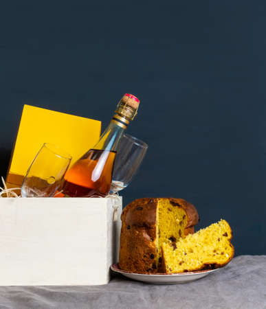 Easter panetone italian with champagne bottle and two glasses on the blue background. Banco de Imagens