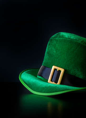 A St. Patrick's day hat of a leprechaun on the black background