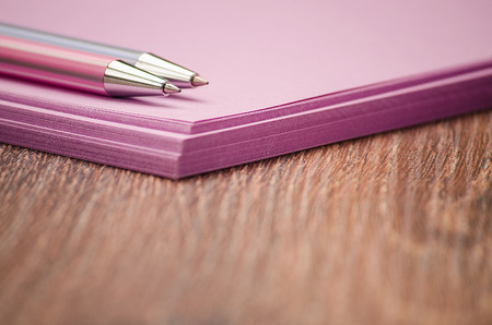 color design: Two handles on the purple stack of paper on the table