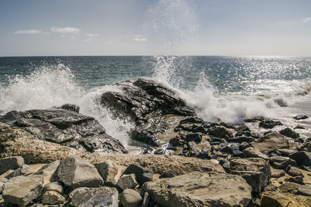 thornhill: Waves crashing over rocks at Thornhill Broom beach in California Stock Photo
