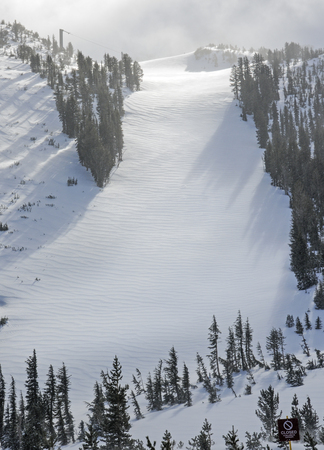 mammoth lakes: Fresh untouched powder on mountainside run of ski resort Stock Photo