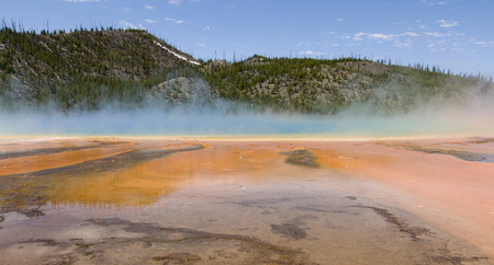 Grand Prismatic Spring as they  walking along path in Midway Geyser Basin, Yellowstone National Park, Wyoming