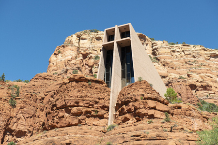 Sedona, Arizona, USA - March 24, 2013: Chapel of the Holy Cross in built into the red-rock buttes