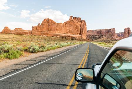 Car driving through Arches National Park, Utah