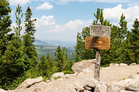 Signpost along Glacier Creek Trail in Rocky Mountain National Park, Colorado