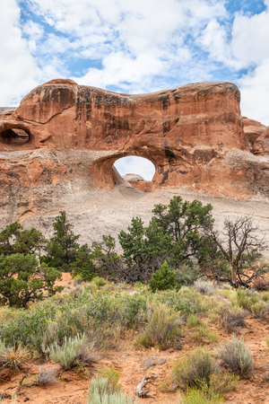 Tunnel Arch in Devils Garden Trail in Arches National Park, Utah Stock Photo