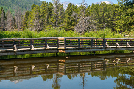 View of bridge from Sprague Lake Trail in Rocky Mountain National Park, Colorado Stock Photo