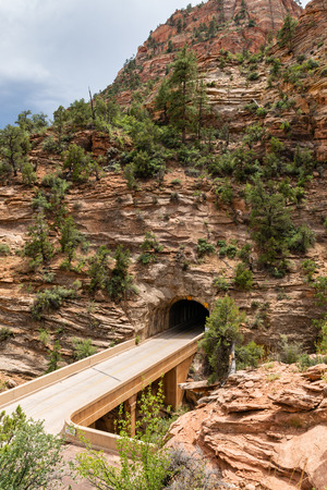 View of the Zion-Mount Carmel Tunnel from the Canyon Overlook Trail in Zion National Park, Utah Stock Photo - 115492633