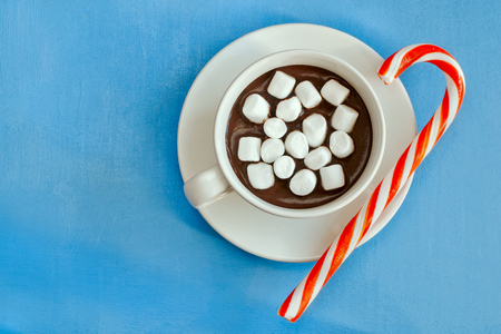 Hot chocolate with marshmallows and sugar cane. Top view. Stock Photo