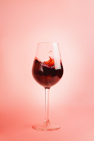 Red wine splash in a glass, dynamic picture, selective focus.