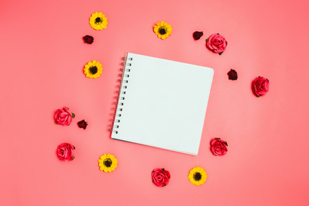 Notebook with white empty copyspace. Flatlay, pink background. Stock Photo