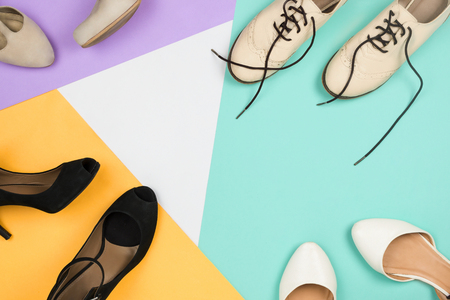 Stylish flatlay with female fashionable shoes: white shoes,blue, violet, white and yellow background. Copyspace Stock Photo