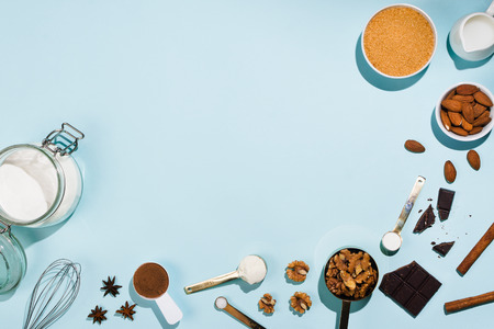 Various products for bakery and baking supplies on blue, flatlay frame Stock Photo