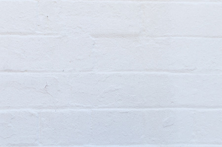 imperfect: Imperfect exterior white painted brick wall background