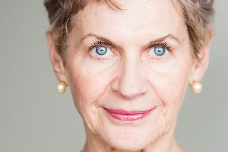 Portrait of older woman with striking blue eyes Фото со стока
