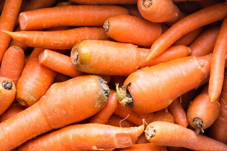 juicing: High angle full frame view of natural looking juicing carrots