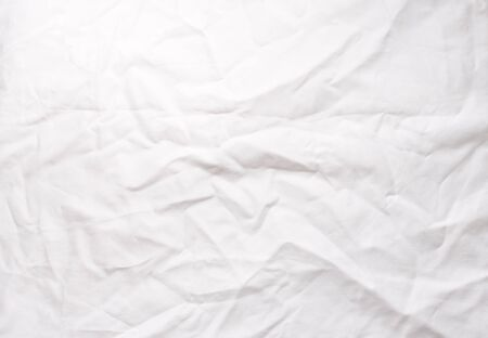 Full frame view of crumpled white cotton tablecloth
